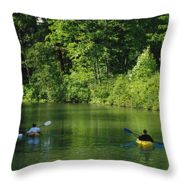 Kayakers Paddle In The Headwaters Throw Pillow by Raymond Gehman