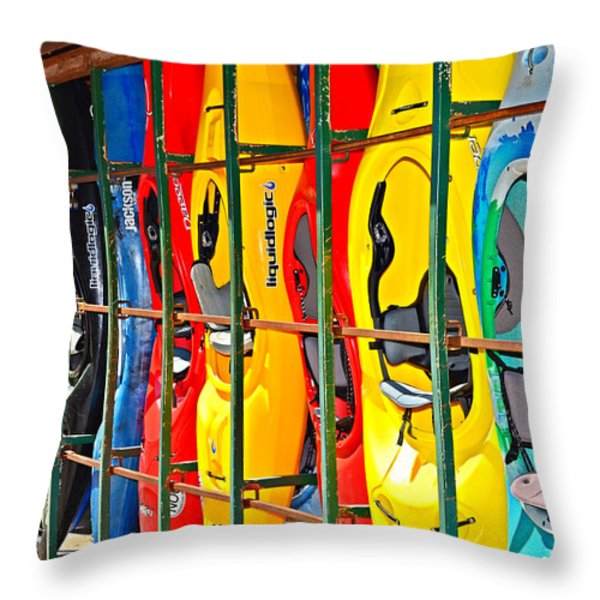 Kayaks In A Cage Throw Pillow by Susan Leggett