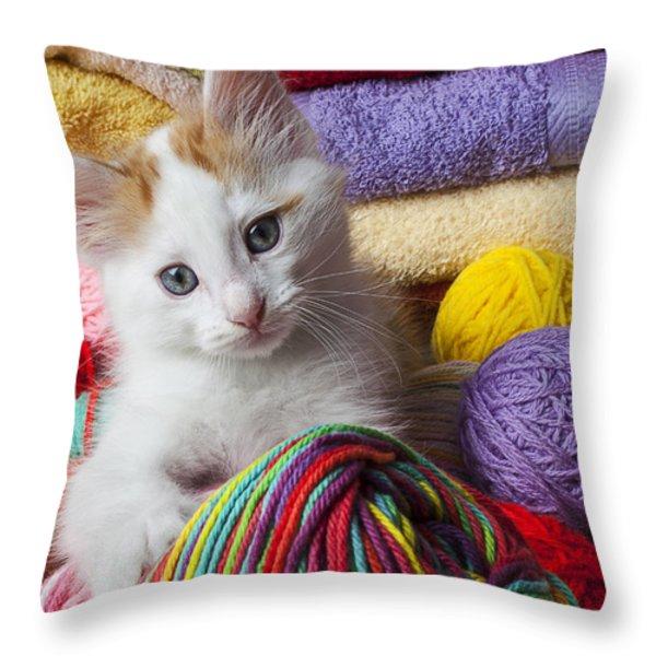 Kitten in yarn Throw Pillow by Garry Gay