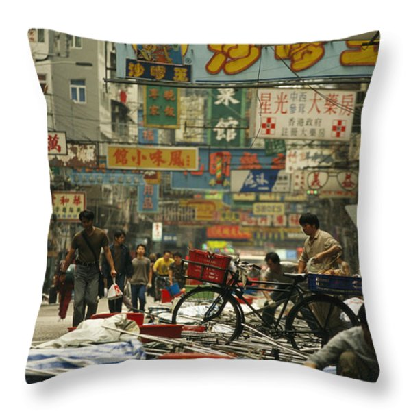 Kowloon Street With Workers Setting Throw Pillow by Justin Guariglia
