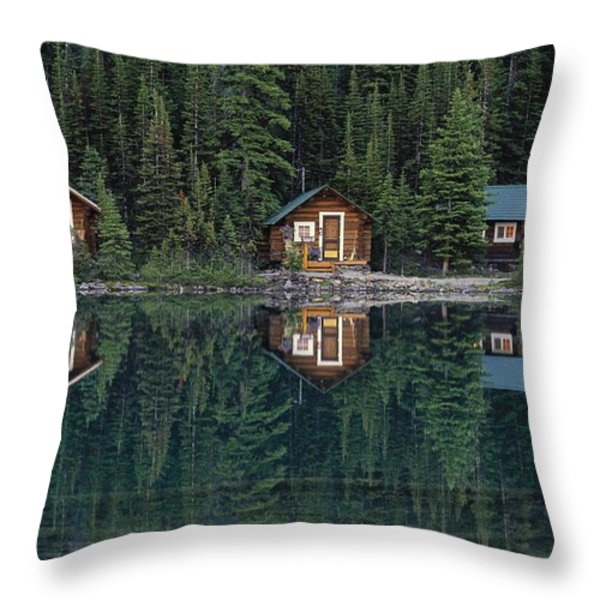 Lake Ohara Lodge Cabins Reflected Throw Pillow by Michael Melford
