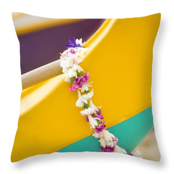 Lei draped over outrigger Throw Pillow by Dana Edmunds - Printscapes