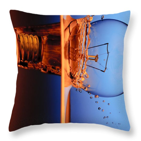 Light Bulb Shot Into Water Throw Pillow by Setsiri Silapasuwanchai