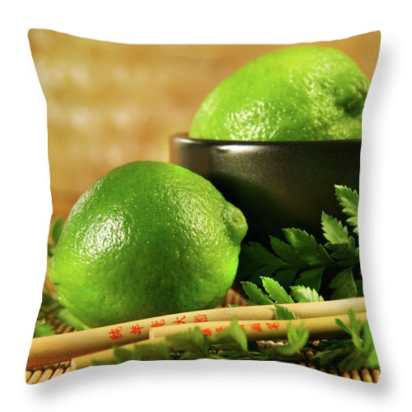 Limes with chopsticks Throw Pillow by Sandra Cunningham