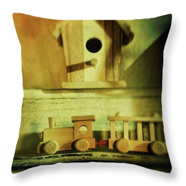 Little wooden train on shelf Throw Pillow by Sandra Cunningham