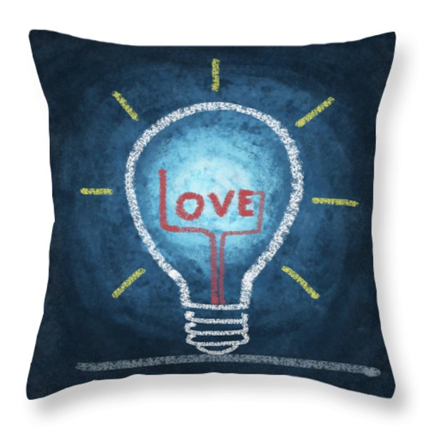love word in light bulb Throw Pillow by Setsiri Silapasuwanchai