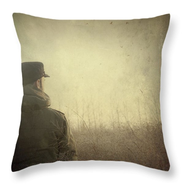 Man alone in Autumn field Throw Pillow by Sandra Cunningham