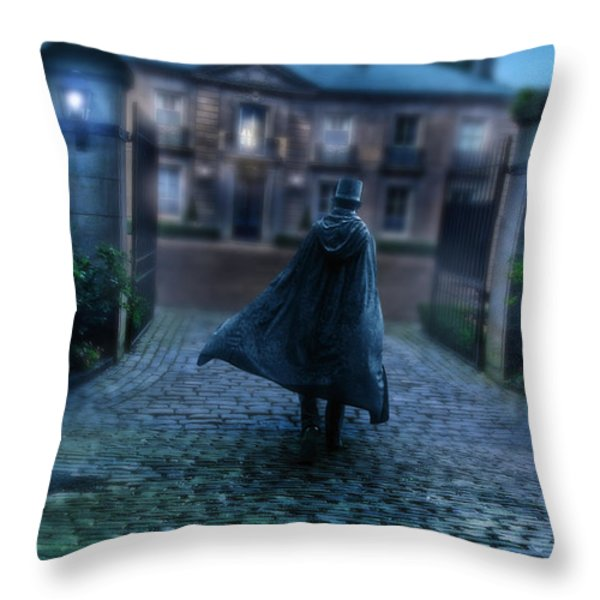 Man In Top Hat And Cape On Cobblestone Street Throw Pillow by Jill Battaglia