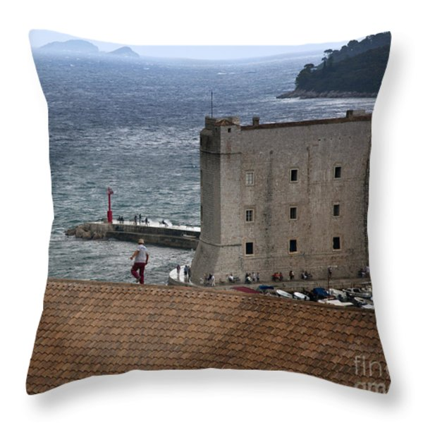 Man On The Roof In Dubrovnik Throw Pillow by Madeline Ellis