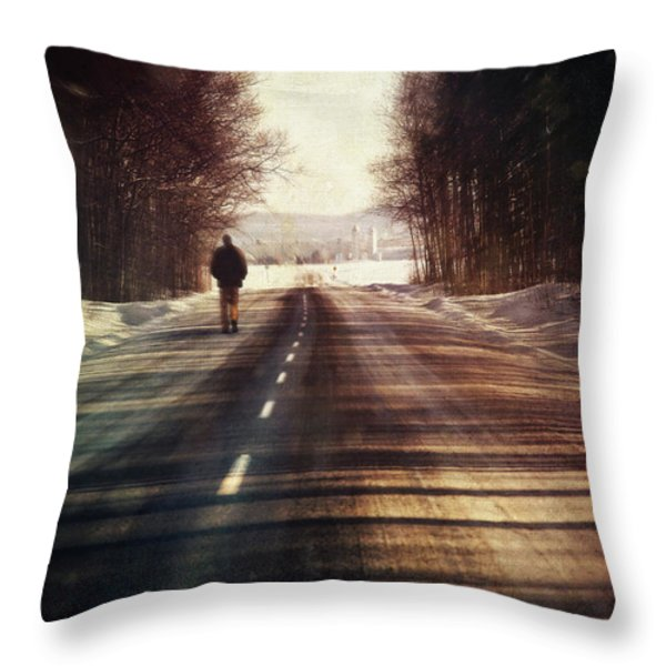 Man Walking On A Rural Winter Road Throw Pillow by Sandra Cunningham