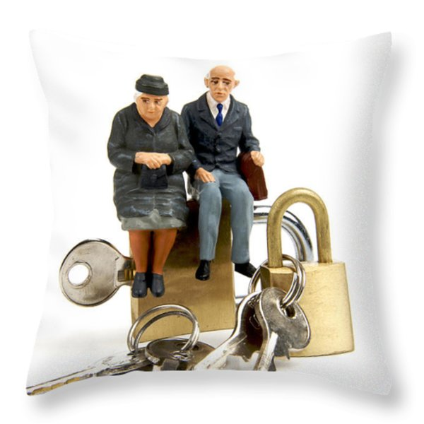 Miniature figurines of elderly couple sitting on padlocks Throw Pillow by BERNARD JAUBERT