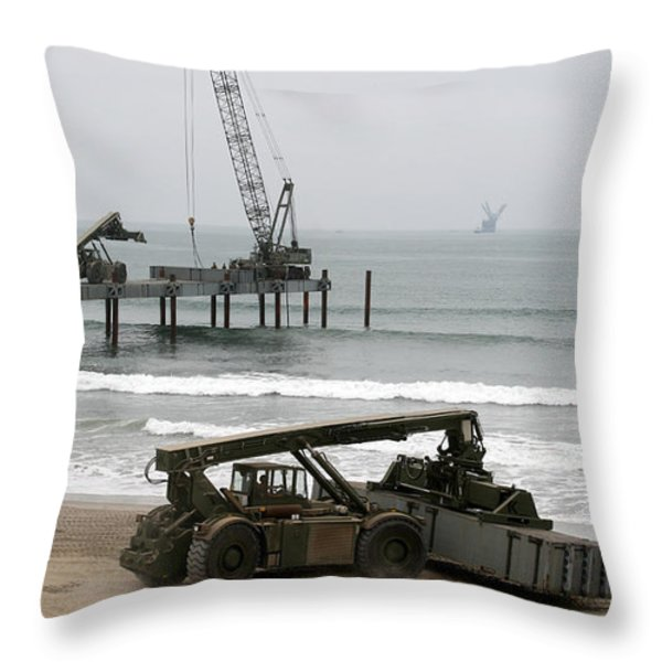Navy Seabees Dismantling An Elevated Throw Pillow by Michael Wood