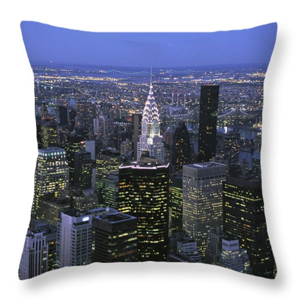 Night View Of The Manhattan Skyline Throw Pillow by Todd Gipstein
