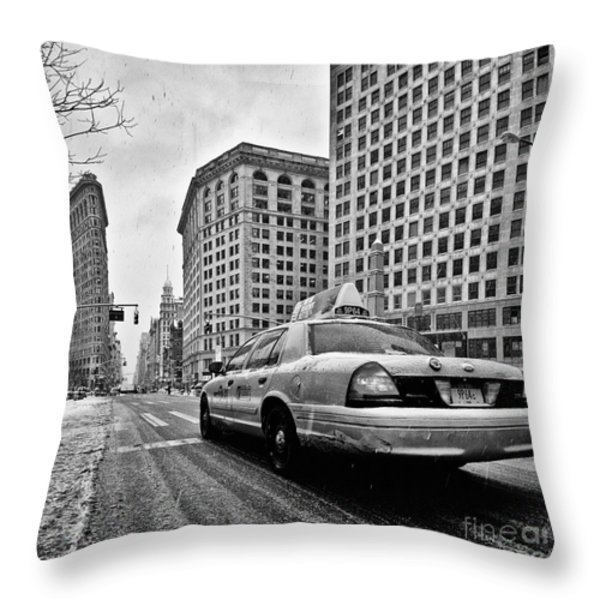 NYC Cab and Flat Iron Building black and white Throw Pillow by John Farnan