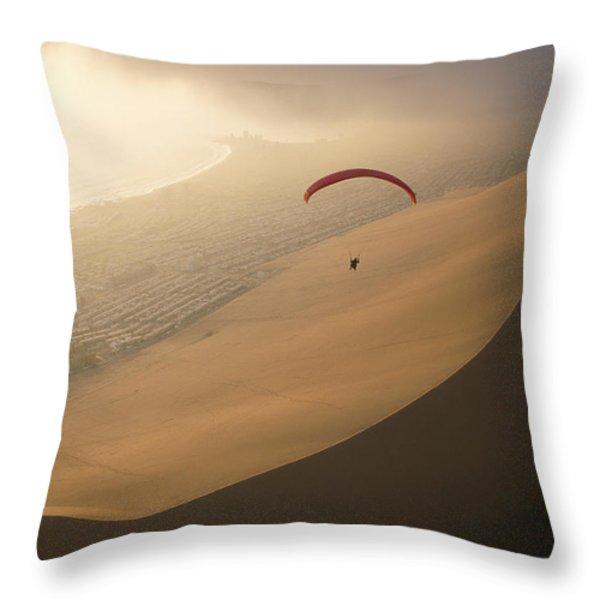 Ocean Gusts Keep A Paraglider Aloft Throw Pillow by Joel Sartore