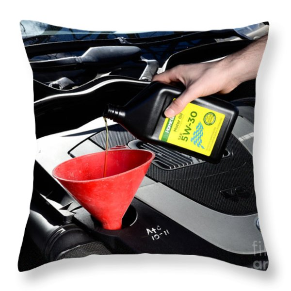 Oil Change Throw Pillow by Photo Researchers