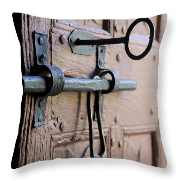 Old door of wood with its worn lock Throw Pillow by BERNARD JAUBERT