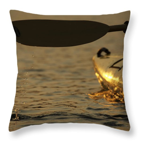 Paddling A Kayak Over Walden Pond Throw Pillow by Tim Laman