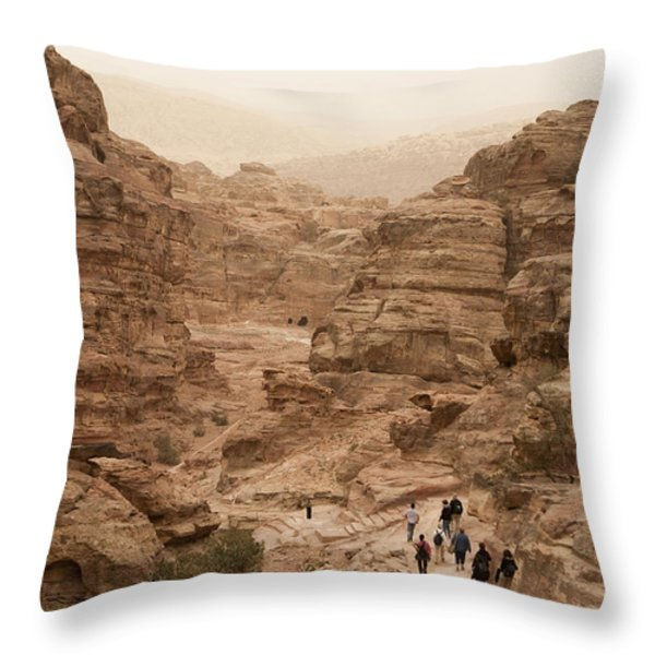People Walk Along A Path Throw Pillow by Taylor S. Kennedy