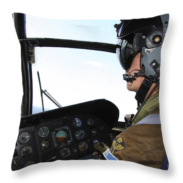 Pilot In The Cockpit Of A Ch-46 Sea Throw Pillow by Daniel Karlsson