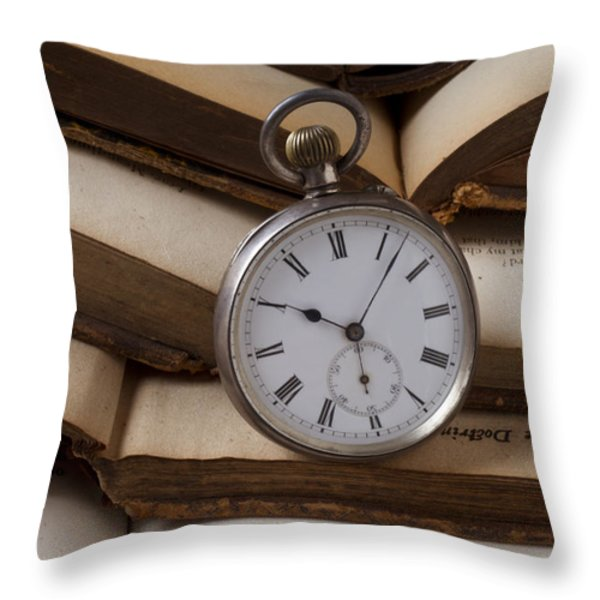 Pocket watch on pile of books Throw Pillow by Garry Gay