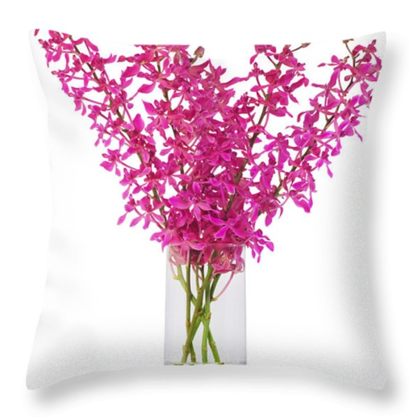 purple orchid in vase Throw Pillow by ATIKETTA SANGASAENG