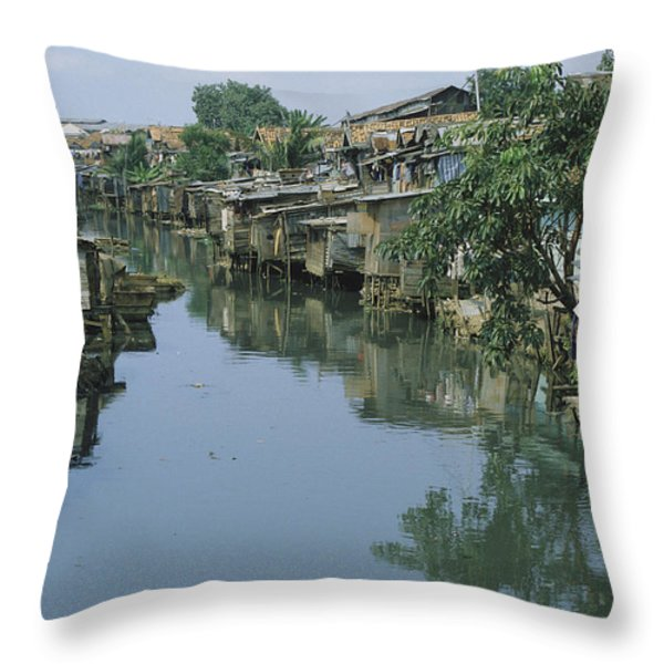 Ramshackle Houses Line A Canal Throw Pillow by Tim Laman
