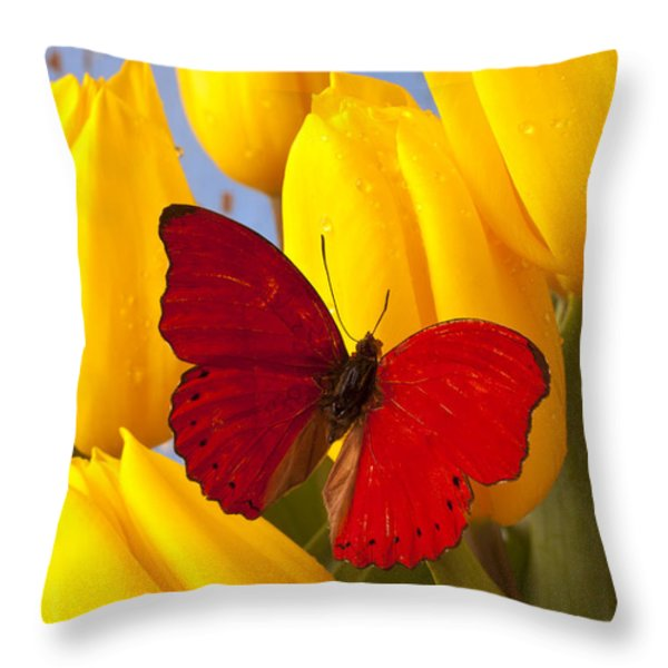 Red butterful on yellow tulips Throw Pillow by Garry Gay