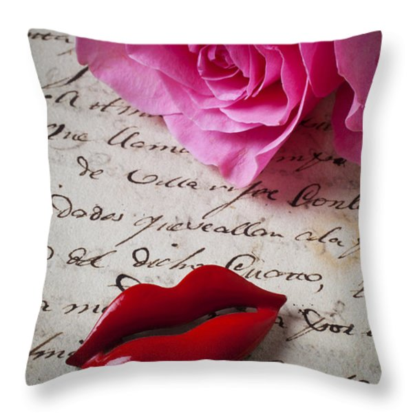 Red lips On Letter Throw Pillow by Garry Gay