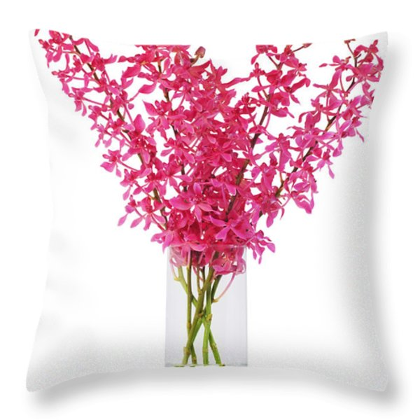 red orchid in vase Throw Pillow by ATIKETTA SANGASAENG