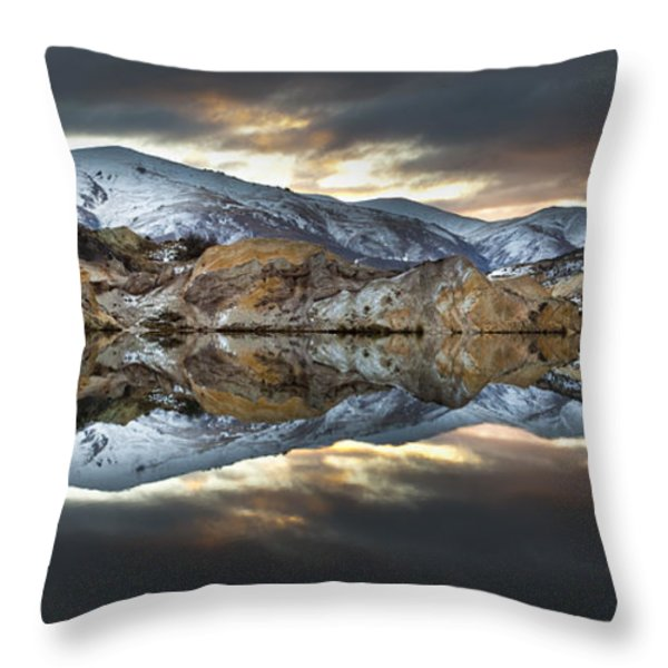 Reflections Of Cliffs On Blue Lake St Bathans Throw Pillow by Colin Monteath