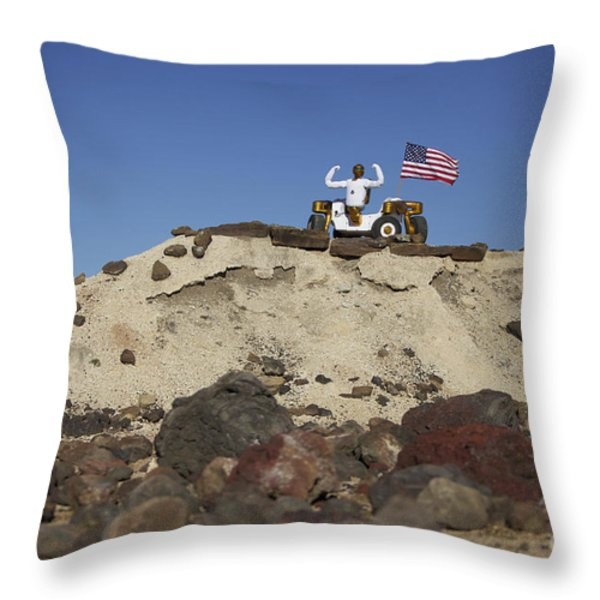Robonaut 2 Poses Atop Its New Wheeled Throw Pillow by Stocktrek Images