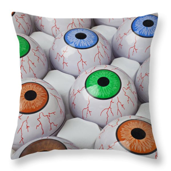 Rows of eyeballs Throw Pillow by Garry Gay