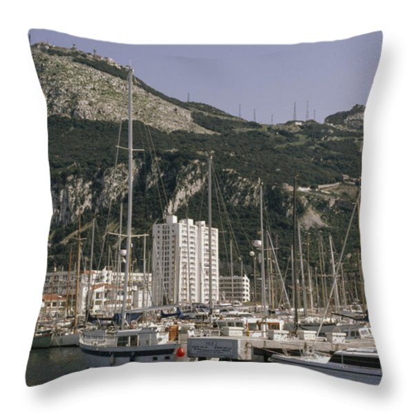 Sailboats Moored In Gibraltar Bay Throw Pillow by Lynn Abercrombie