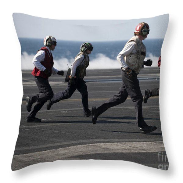 Sailors Clear The Landing Area Throw Pillow by Stocktrek Images