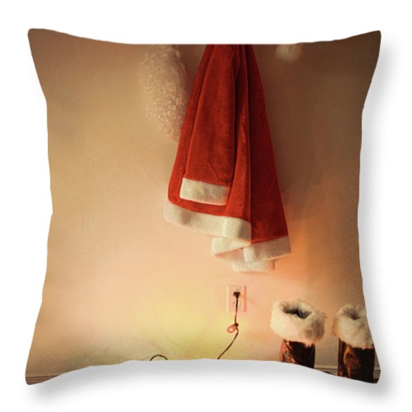 Santa costume hanging on coat hook with christmas lights Throw Pillow by Sandra Cunningham