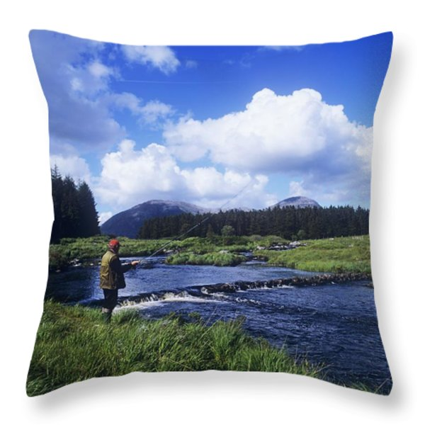 Side Profile Of A Man Fly-fishing In A Throw Pillow by The Irish Image Collection