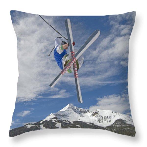 Skiing Aerial Maneuvers Off A Jump Throw Pillow by Gordon Wiltsie