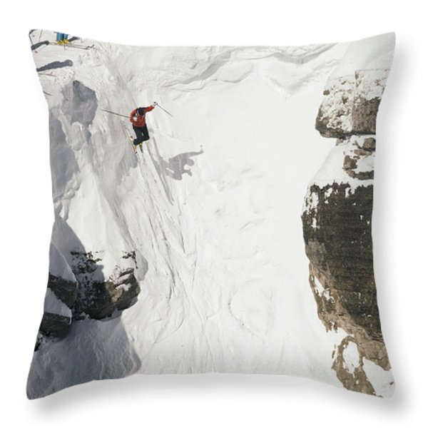 Skilled Skiers Plunge More Than 15 Feet Throw Pillow by Raymond Gehman