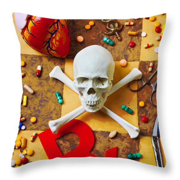 Skull and bones with medical icons Throw Pillow by Garry Gay