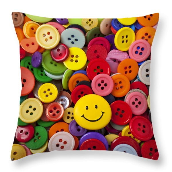 Smiley face button Throw Pillow by Garry Gay