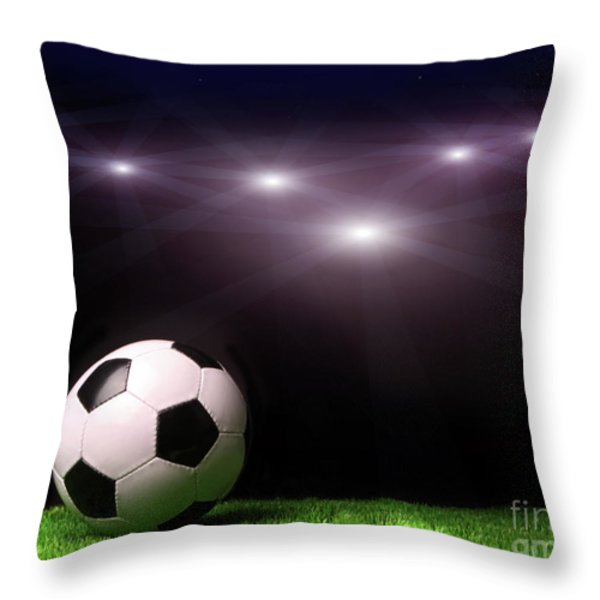 Soccer Ball On Grass Against Black Throw Pillow by Sandra Cunningham