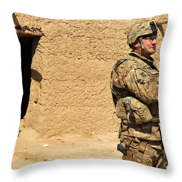 Soldier Stands Guard During A Routine Throw Pillow by Stocktrek Images