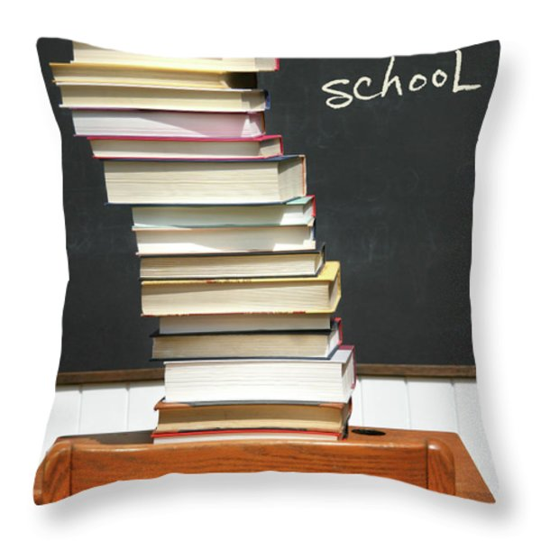 Stack Of Books On An Old School Desk Throw Pillow by Sandra Cunningham