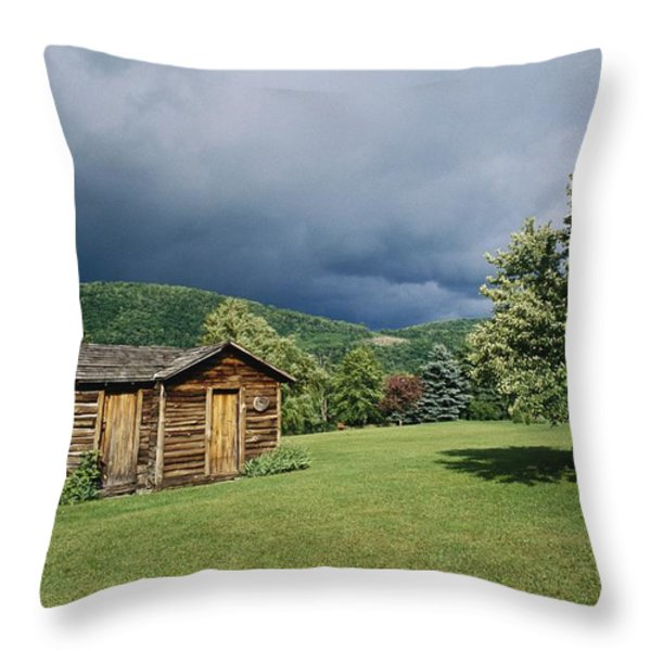 Storm Clouds Form Above A Log Cabin Throw Pillow by Raymond Gehman