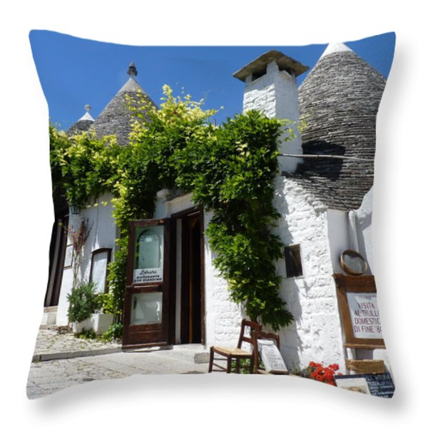 Street Scene In Alberobello Throw Pillow by Carla Parris