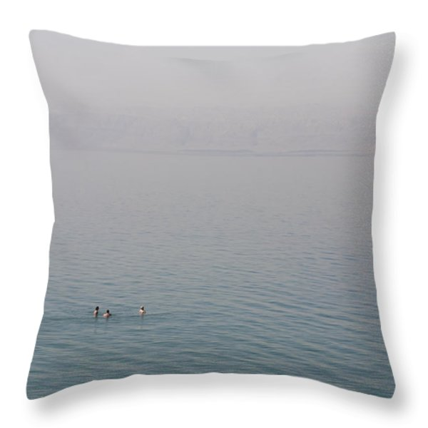 Swimmers Enjoy The Waters Of The Dead Throw Pillow by Taylor S. Kennedy