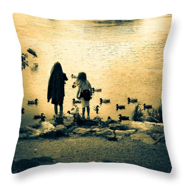 Talking to ducks Throw Pillow by Bob Orsillo