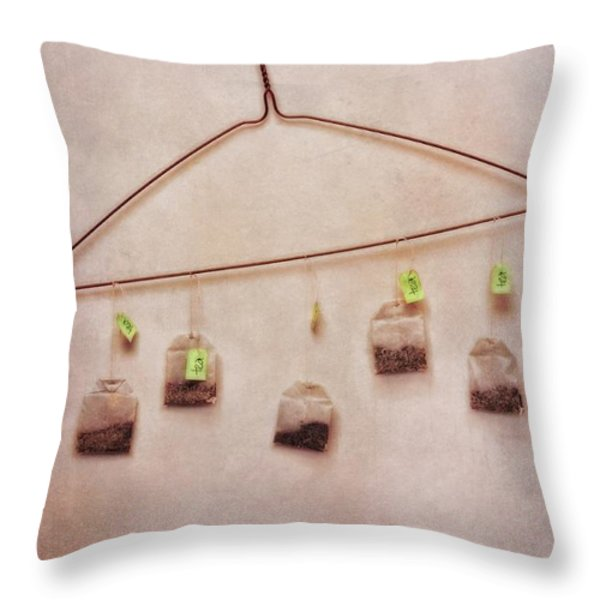 tea bags Throw Pillow by Priska Wettstein