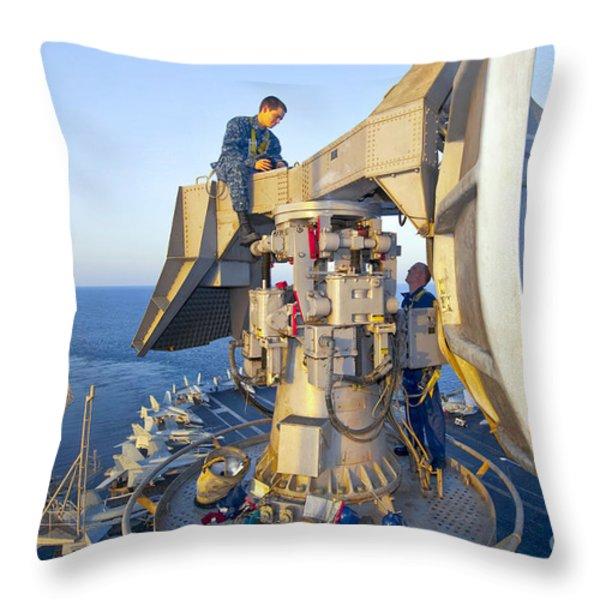 Technicians Perform Maintenance Throw Pillow by Stocktrek Images